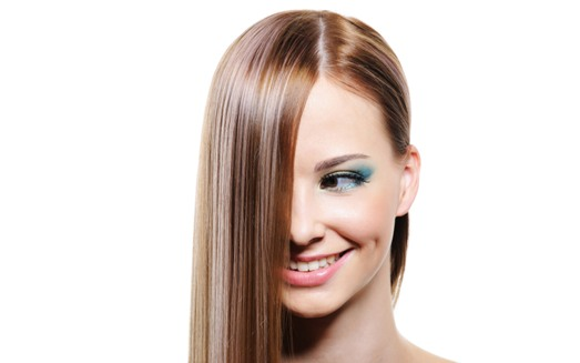 Creative hairstyle with smooth long female hair - close-up